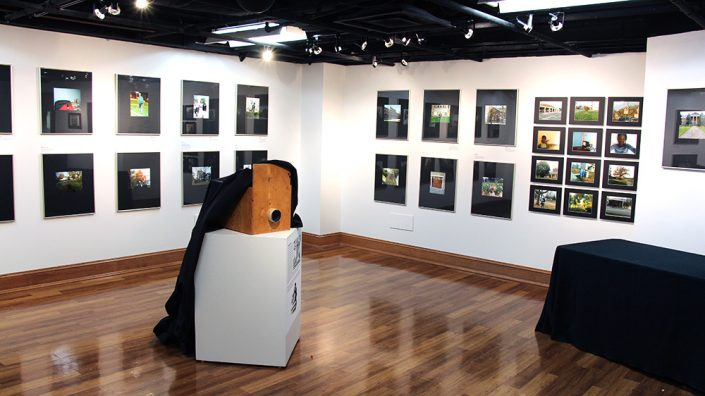 An art gallery with various framed photographs on the wall.