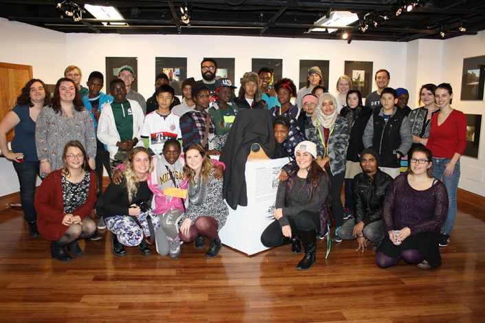 A group of students standing in an art gallery.