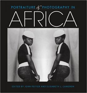 Booc cover showing a black and white photo of two young men wearing white hats and dark shirts.