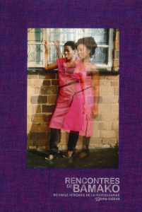 A bright purple book cover featuring a photo of a woman in a pink dress.